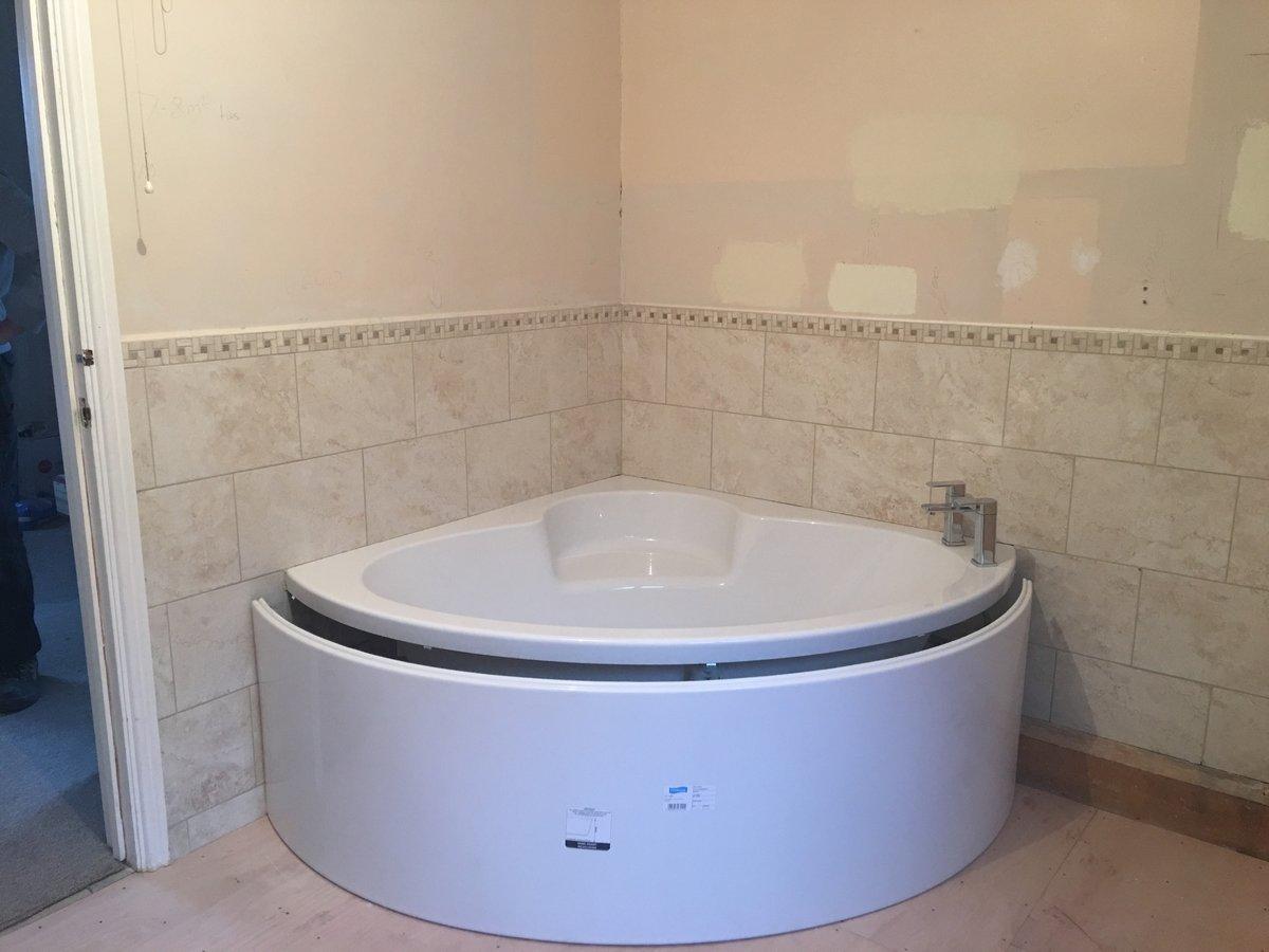 image showing bathroom refurbishment corner bath joys green