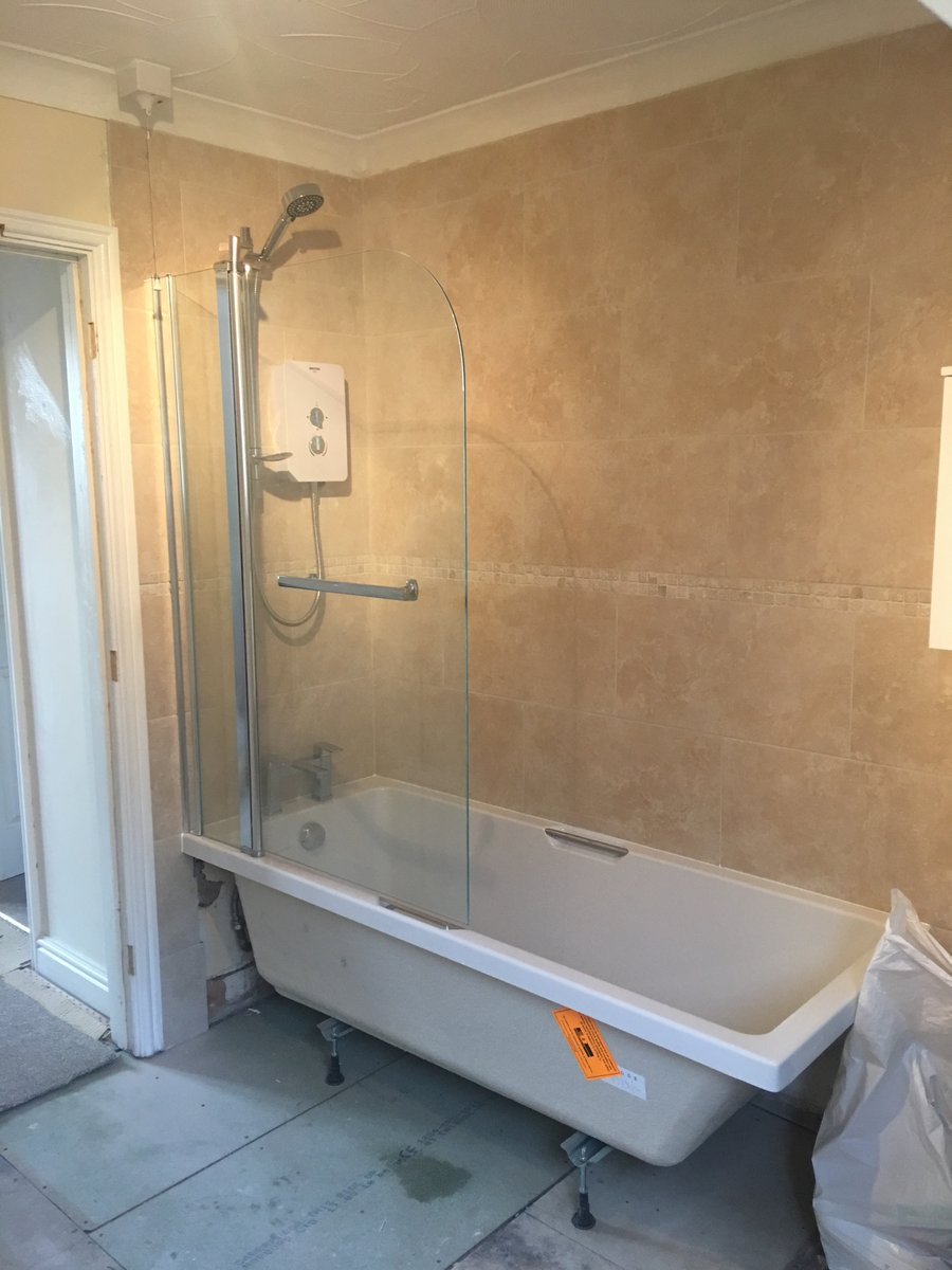 Image of bathroom refurbishment corner bath joys green