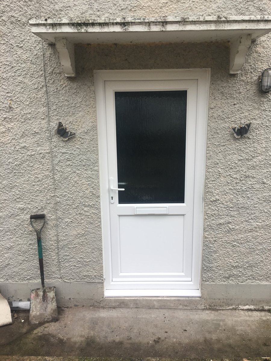 Image of fully glazed to half glass front door tintern