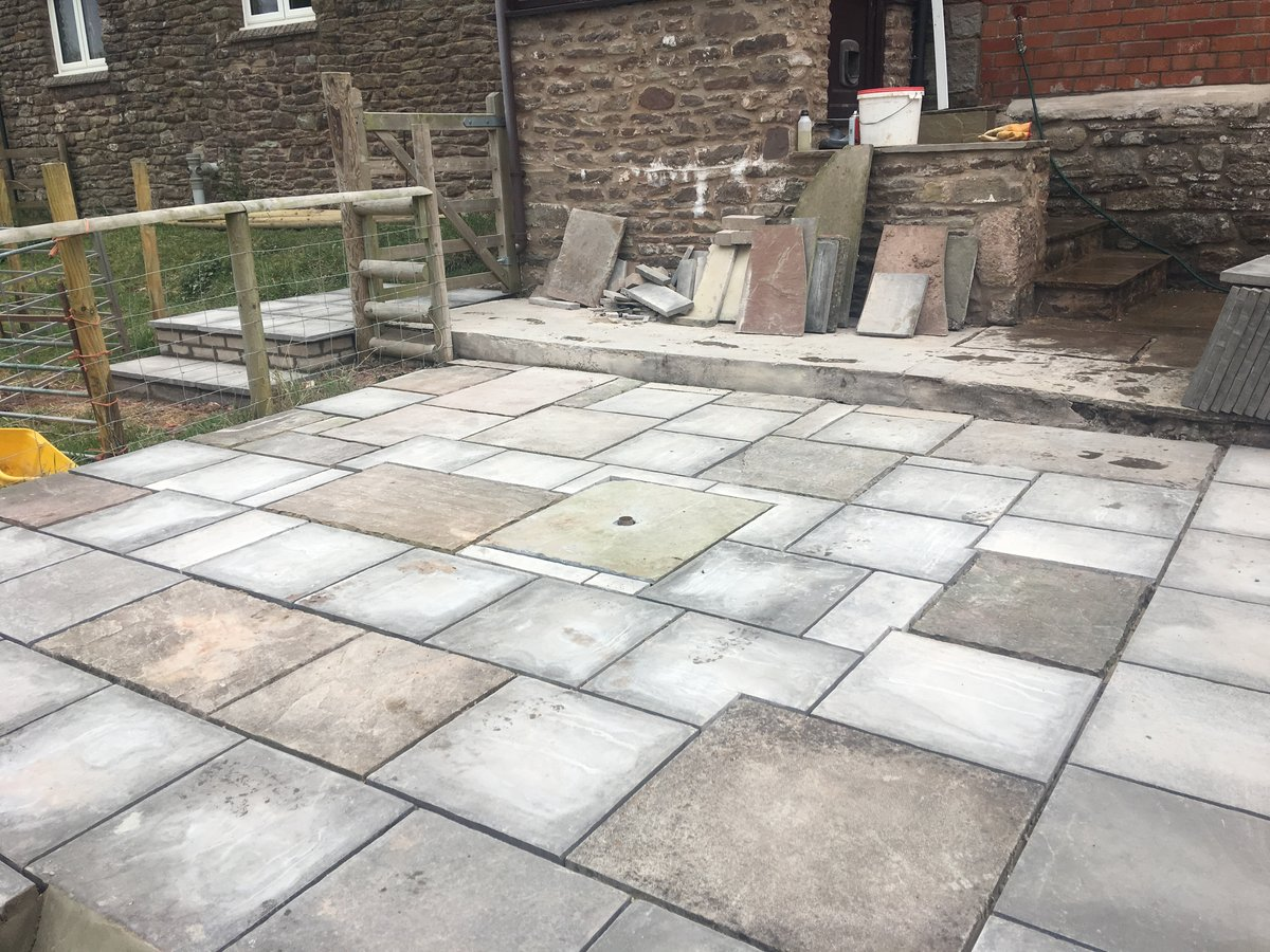 Image of patio using mixed new old slabs trellech grange