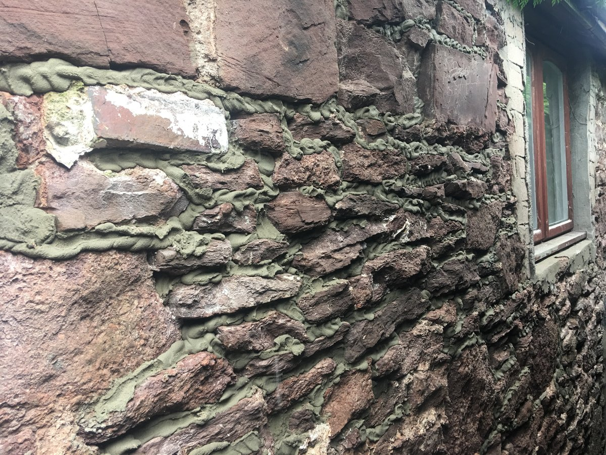 Image of pointing rendering old stone wall
