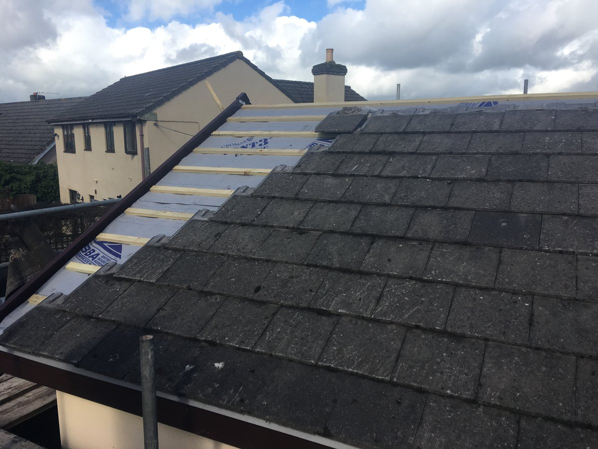 Image of roof replacement using existing tiles bury hill